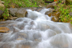 Relax after working on weekend with Stream water fall at chathaburi in thailand. Royalty Free Stock Photos