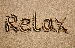 Relax, written on a beach. Royalty Free Stock Image