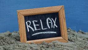 Relax written Stock Images