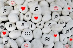Free Relax Written On White Stones Stock Images - 50224574