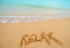 Relax written in sand Royalty Free Stock Images