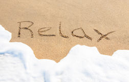 Relax - written in the sand Royalty Free Stock Photography