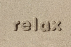Relax written in sand letters Stock Photography
