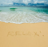 Relax written in a sandy tropical beach royalty free stock photos