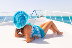 Relax on the yacht cruise. Beautiful woman in hat relaxing on the yacht cruise Royalty Free Stock Photos