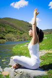 Relax and Yoga Outdoors. Young woman practices yoga and relax in nature Stock Images