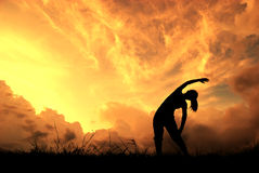 Relax yoga woman and sunset silhouette Royalty Free Stock Photography