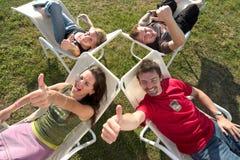 Relaxamento com polegares acima Fotos de Stock