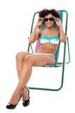 Relaxamento modelo da roupa interior da forma no deckchair Foto de Stock Royalty Free