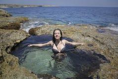 Relaxamento na água Imagens de Stock Royalty Free