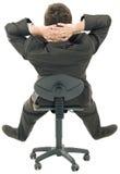 Relaxamento no entalhe da cadeira imagem de stock royalty free