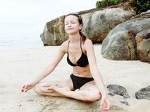 Relaxation. Yoga meditation on the beach Royalty Free Stock Photos