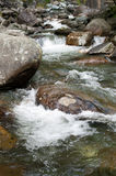 Relaxation. Large stones in the mountain river Royalty Free Stock Image