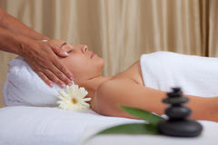 Relaxation. Woman getting relaxing spa head massage Royalty Free Stock Photo