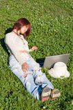 Relaxation. Teenager relaxing outdoors with notebook Stock Images