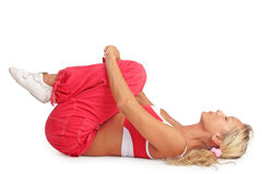 Relaxation. Blonde sportive girl laying on her back and relaxing after the training Royalty Free Stock Images