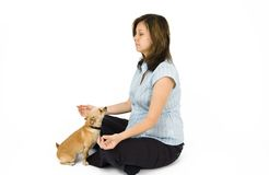 Relaxation. A pregnant woman does yoga with a dog Royalty Free Stock Image