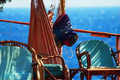 Relaxation area with chairs and hammocks above sea level Stock Photography