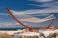 Relaxation in Aruba. A hammock awaits on a beautiful beach in Aruba Royalty Free Stock Photos