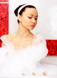 Relaxation in the bath. Young slim woman relaxing in the bathroom Royalty Free Stock Photography
