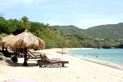 Relaxation Bay. Chaise lounge chairs on beach in Bequia, SVG Royalty Free Stock Photography