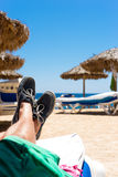 Relaxation on the beach. Resting during a vacation on a tropical beach Royalty Free Stock Photo