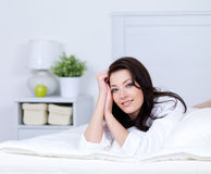Relaxation of beautiful woman on a bed Stock Photos
