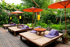 Relaxation bed near the garden. Traditional Thai umbrella and relaxation bed near the garden Stock Image