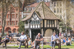 Relaxation. Benches at  Soho Square, London, a popluar lunchtime venue for workers in the area Stock Images