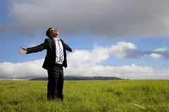 Relaxation businessman standing on the meadow. And enjoy sunshine Royalty Free Stock Image
