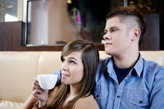 Relaxation in cafe. Young couple having a coffee break in cafe Royalty Free Stock Image