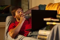 Relaxation with cigarette during learning Royalty Free Stock Photo