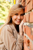 Relaxation in the city, beautiful girl near brick wall Royalty Free Stock Image