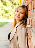 Relaxation in the city, beautiful girl near brick wall Royalty Free Stock Images