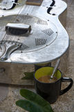 Relaxation, comfort, leisure, vacation, guitar coffee. Royalty Free Stock Images