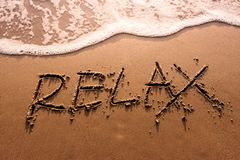 Relaxation Concept, Relax Word Written on Summer Sand Beach with. Wave of Sea, Top View stock photos