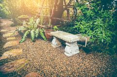 Free Relaxation Corner With Intricate Granite Bench. Vintage Effect T Stock Image - 103830901