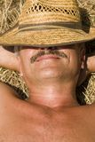 Relaxation At Countryside. Smiling Man On A Haystack Stock Photo