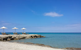 Relaxation on crystalline Mediterranean Sea on a white sand beach Stock Photo