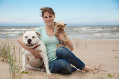 Relaxation with dogs. Happy young woman walking with dogs Stock Photo