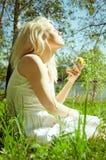 Relaxation and enjoying the nature. Beautiful blond girl enjoying the nature Royalty Free Stock Image