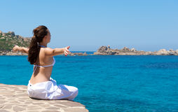 Relaxation exercices on the beach Royalty Free Stock Photo