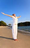 RELAXATION EXERCISE ON BEACH Royalty Free Stock Images