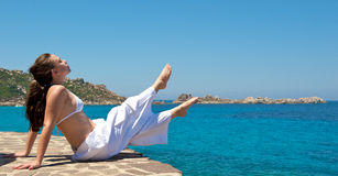 Relaxation exercises on the beach Royalty Free Stock Photography