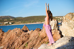 Relaxation exercises with sea view Stock Photography