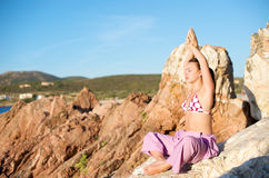 Relaxation exercises with sea view Stock Image