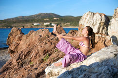 Relaxation exercises with sea view Stock Images