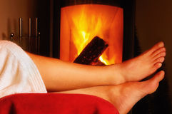 Relaxation Beside The Fireplace Royalty Free Stock Photos