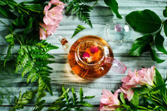 Relaxation with a green detoxing tea Royalty Free Stock Photo