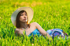 Relaxation on a green field in Stock Photo